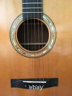 Left handed Hand made accoustic guitar. Cuban Mahogany back, sides and neck